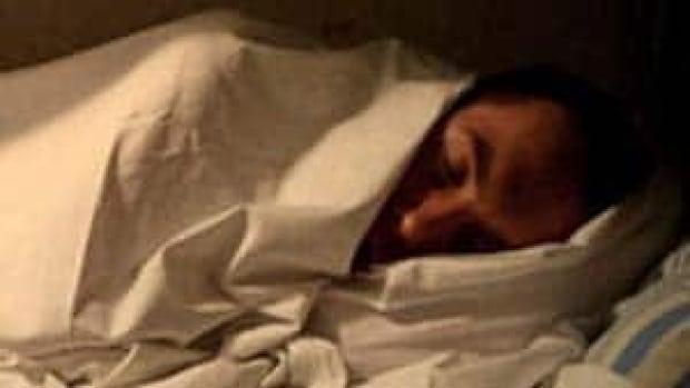 si-man-sleeping-bed-getty