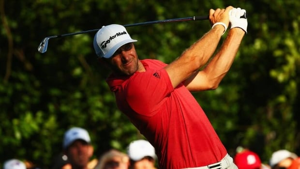 Dustin Johnson hits his tee shot on the tenth hole during the first round of the PGA Championship on August 8, 2013 in Rochester, New York.