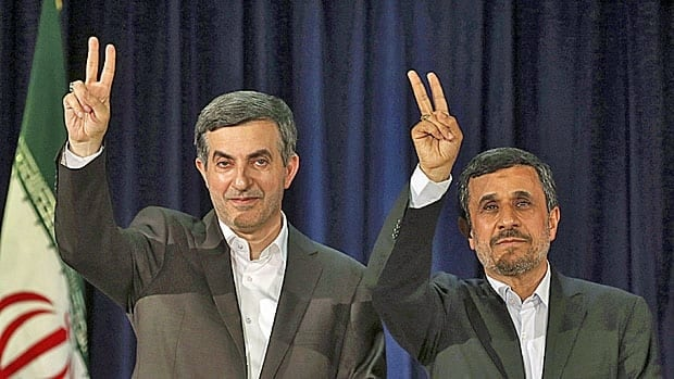 Outgoing Iranian President Mahmoud Ahmadinejad (R) and his close ally and would-be successor Esfiandiar Mashaei greet supporters after registering Mashaei's candidacy for the presidential election on June 14.