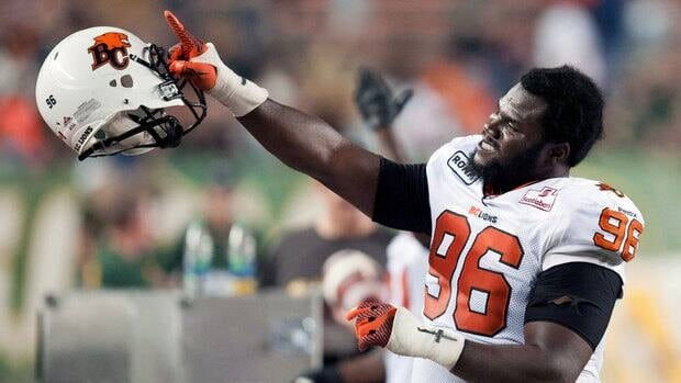 B.C . Lions defensive line Khalif Mitchell gestures to fans just prior to winning against the Edmonton Eskimos on Saturday.