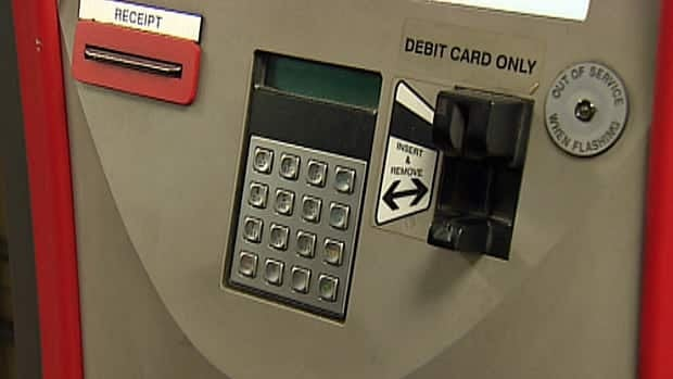Toronto police have laid charges against five people who are alleged to have used fraudulent debit cards to buy monthly transit passes at TTC vending machines.