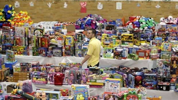 Volunteer Anthony Vessicchio of East Haven, Conn., helps to sort tables full of donated toys at the town hall in Newtown, Conn., part of the generous gifts of items and money sent to help out following the shooting massacre at Sandy Hook Elementary School in Newtown.