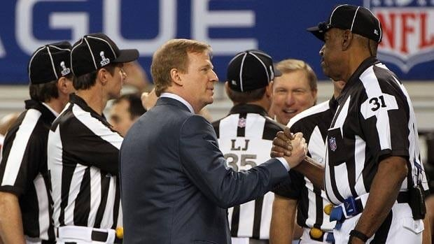 NFL commissioner Roger Goodell shakes umpire Chad Brown's hand prior to the 2011 Super Bowl in Dallas.