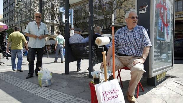 A crisis-hit housepainter looks for casual employment in Athens Monday. The same day, European Union finance officials pleaded with Greece to stay the course on its painful austerity program.