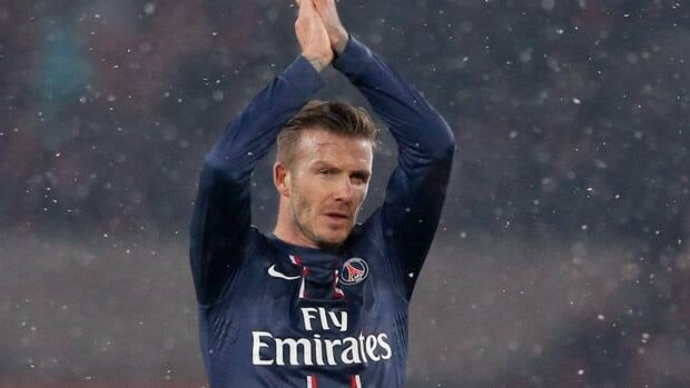 Paris Saint Germain's David Beckham applauds the crowd at the end of their Ligue 1 soccer match against Marseille at Parc des Princes Stadium in Paris on Sunday.