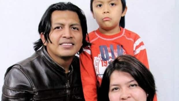 Nerlin Lizbeth Sarmiento, 32, is shown with her husband Florentino Jajoy and her seven-year-old son, Omar. Sarmiento has been charged with first-degree murder in Omar's death.