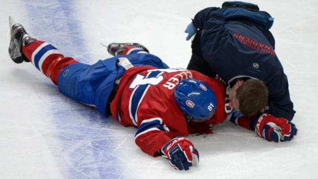 Montreal Canadiens' Lars Eller lay injured on the ice following a hit by Ottawa Senators' Eric Gryba (not shown) during second period of Game 1. He spent the night in hospital and Gryba faces the NHL Friday for the hit.