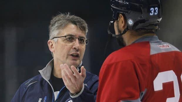 Winnipeg Jets head coach Claude Noel talks to Dustin Byfuglien on Jan. 15, just days before the season began.