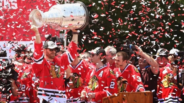 Members of the Chicago Blackhawks celebrate their Stanley Cup win over the Boston Bruins at a rally in Grant Park on Friday in Chicago.