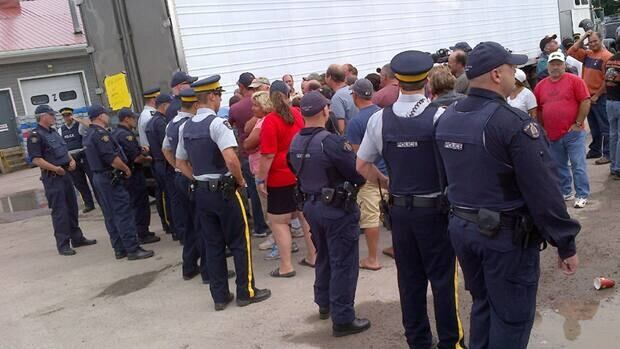 About 200 lobster fishermen blocked a processing plant in Shediac on Aug. 2 to protest cheap U.S. lobster.