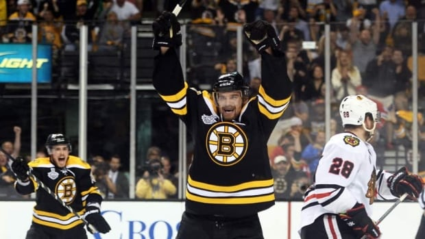 Daniel Paille (20) of the Boston Bruins celebrates after scoring a goal in the second period against the Chicago Blackhawks in Game 3 of the Stanley Cup final on Monday.