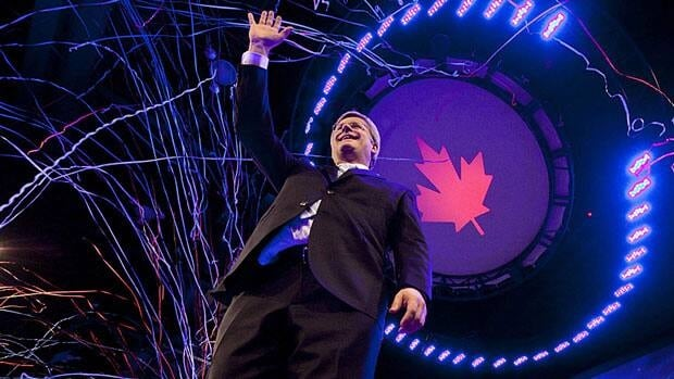 Prime Minister Stephen Harper waves following his victory speech in Calgary on election night, May 2, 2011. Census figures show a demagraphic shift toward Western Canada that is bringing with it more political power.