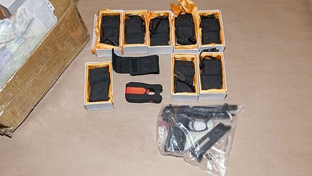 Police seized a number of tasers and other weapons from a Dundas home. (Hamilton Police Service)