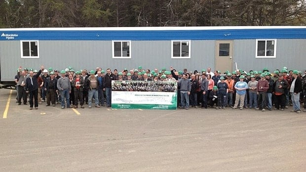 About 225 Kent Homes employees celebrated landing the largest contract in the company's history.