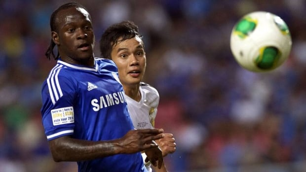 Victor Moses, left, struggled to establish himself with Liverpool.