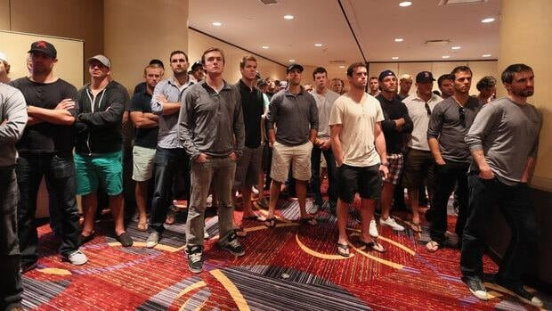 Players attend the press conference following NHLPA meetings in New York on Thursday.
