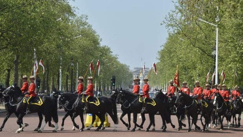 Mounties guard the Queen for a day | CBC News