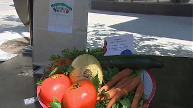 Officials showed off the types of foods that would be available at the Downtown Farmers' Market beginning July 4 in Winnipeg.