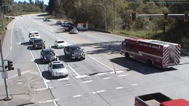 Emergency crews decended upon Lougheed Highway near 240 Street to come to the aid of an apparent shooting victim. This image looking east along Lougheed Highway was captured by the DriveBC webcam at 12:55 p.m. Saturday.