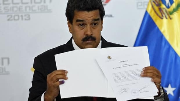 Venezuela's interim President Nicolas Maduro holds the official certificate declaring him winner of the presidential election at the Electoral Council in Caracas on April 15. Venezuela's government-friendly electoral council quickly certified his razor-thin presidential victory.