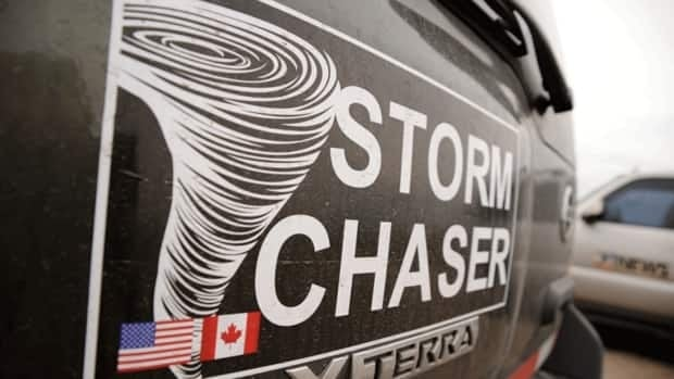 Greg Johnson's truck identifies him as a cross-border storm chaser who travels throughout Canada and the U.S. on the hunt for severe weather.
