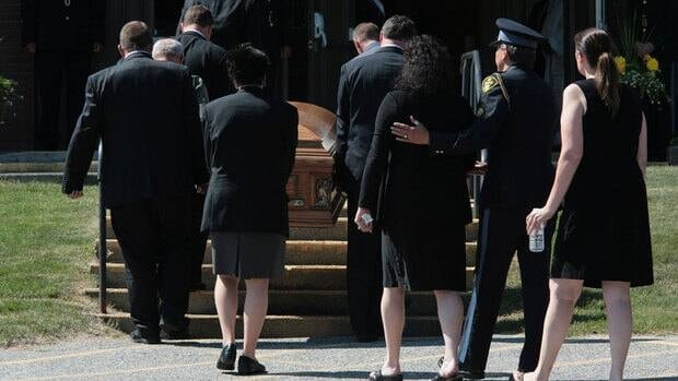 The casket carrying Doloris Perizzolo arrives at Our Lady of Fatima Church in Elliot Lake, Ont., for the funeral of one of two victims in the Algo Centre Mall roof collapse.