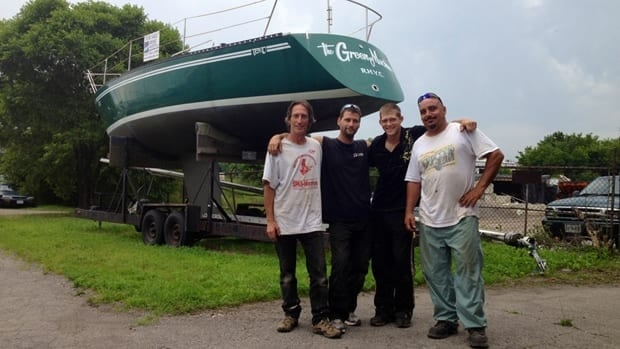 Ed Jocelyn may be gone, but the roofing-crew guys like having his yacht on the premises. From left, Randy Dawson, Kris Jamieson, Stefan Cunningham and Marty Harrison.