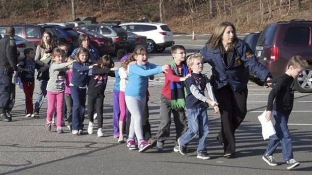 Children are led away from Sandy Hook Elementary School in Newtown, Conn., last Dec. 14 after gunman Adam Lanza killed 20 students and six adults at the school. Recordings of emergency calls to 911 on the day were to be released Wednesday.