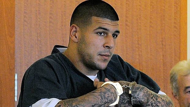 Former New England Patriots football tight end Aaron Hernandez stands during a bail hearing Thursday in Fall River, Mass.