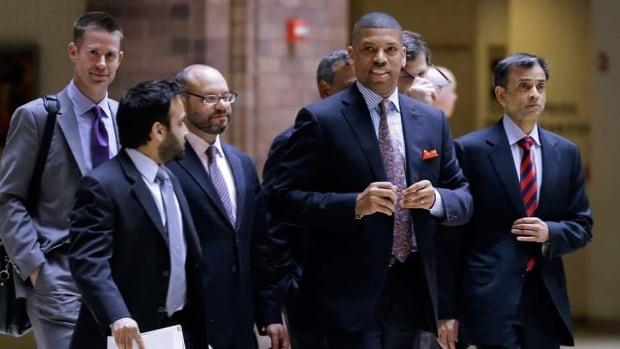 Sacramento mayor Kevin Johnson, right front, walks out of an NBA Board of Governors meeting during a break Wednesday, May 15, 2013, in Dallas, Texas.