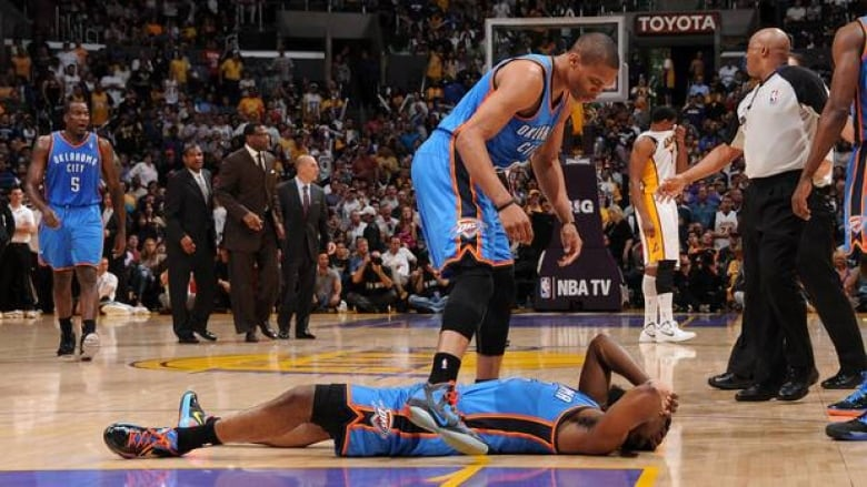 4080d80c59e James Harden of the Oklahoma City Thunder lays on the floor after being  elbowed by Metta World Peace of the Los Angeles Lakers at Staples Center on  April 22 ...