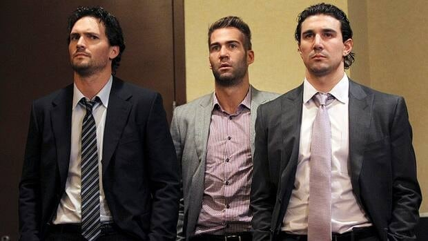 Winnipeg Jets' Ron Hainsey, left, is seen here listening as NHL commissioner Gary Bettman and deputy commissioner Bill Daly speak to reporters on Thursday in New York alongside Anaheim Ducks' Daniel Winnik, centre, and Chicago Blackhawks' Chris Campoli.