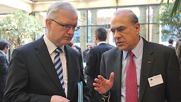 Angel Gurria, the head of the Paris-based international development body OECD, right, talks with European Commissioner for Economic and Monetary Affairs Olli Rehn prior to a media conference, in Brussels, Tuesday, March 27, 2012. Gurria called for the 17 countries that use the euro to boost their crisis firewalls to at least 1 trillion euros ($1.3 trillion).