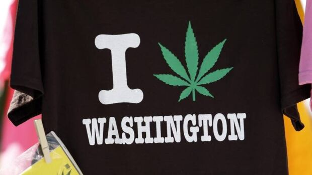 A tee shirt is displayed at the first day of Hempfest in Seattle, Aug. 2013. Thousands packed the Seattle waterfront park for the opening of a three-day marijuana festival — an event that was partly a victory celebration after the legalization of pot in Washington and Colorado last fall.