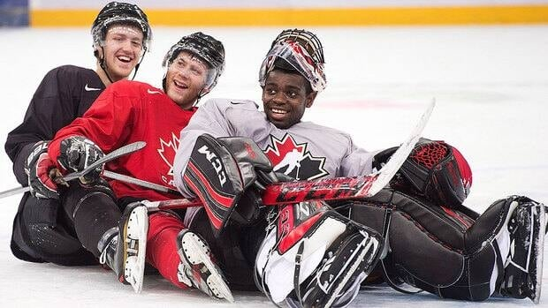 From left, Canadian teammates Dougie Hamilton, Anthony Camara and Malcolm Subban ham it up for the cameras, pretending to bobsleigh at a recent practice. Canadian players are talking of the unifying effect of travelling so far from home.