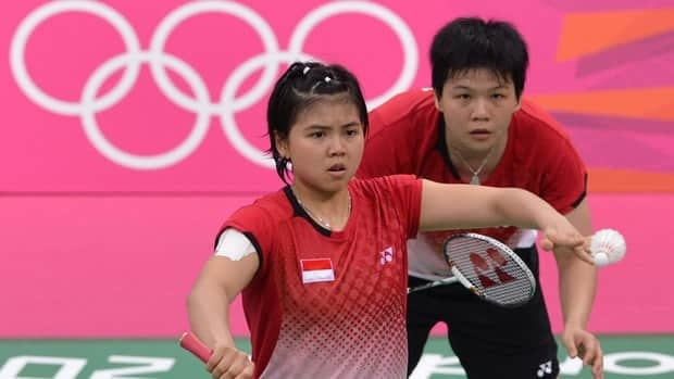 Greysia Polii, left, and teammate Meiliana Jauhari were thrown out of the Olympics for trying to deliberately lose group matches.