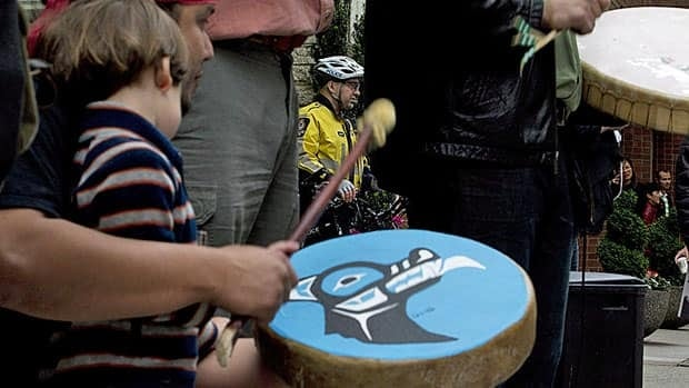 Tsilhqot'in national government members do traditional drumming as they protest a proposed mine in their territory outside in Vancouver last June. The B.C. and federal governments have been ordered to pay partial court costs in a land claims case involving the First Nation.