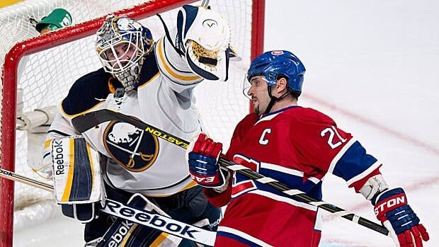 Buffalo goalie Jhonas Enroth and Montreal captain Brian Gionta battle during a game in March.