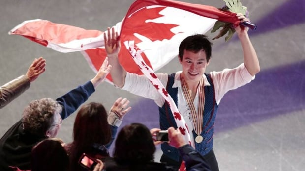 Patrick Chan, shown here doing a victory lap after winning gold in London, Ont., on Saturday, captured his third straight world title.