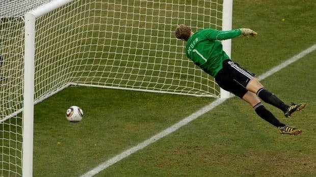 Germany goalkeeper Manuel Neuer looks at the ball that hit the bar to bounce over the line during the 2010 World Cup round of 16 soccer match between Germany and England June 27, 2010, in Bloemfontein, South Africa.