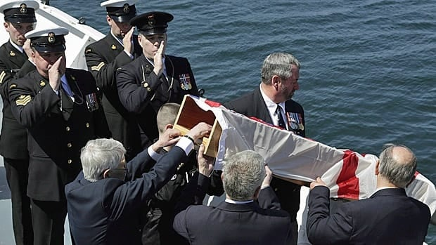 Family members and veterans participate in a burial at sea ceremony on HMCS Sackville during which the ashes of 21 members of Canada's military placed in the waters outside Halifax harbour on Sunday, May 5, 2013 during a ceremony marking the Battle of the Atlantic.