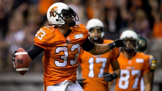 B.C. Lions' Andrew Harris, left, during a game against the Edmonton Eskimos in Vancouver, B.C., on Saturday July 20, 2013.
