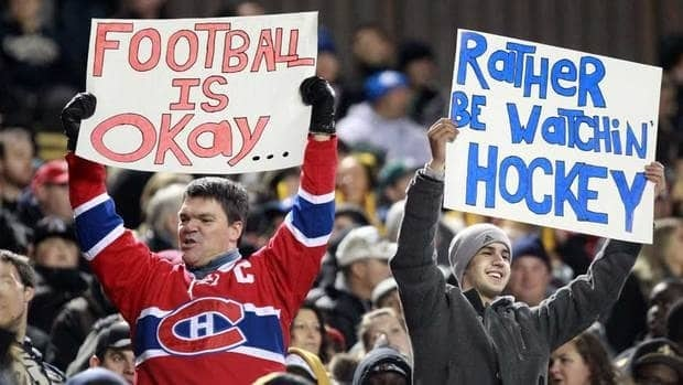Fans holds signs hoping for the NHL lockout to end during a CFL game in October.