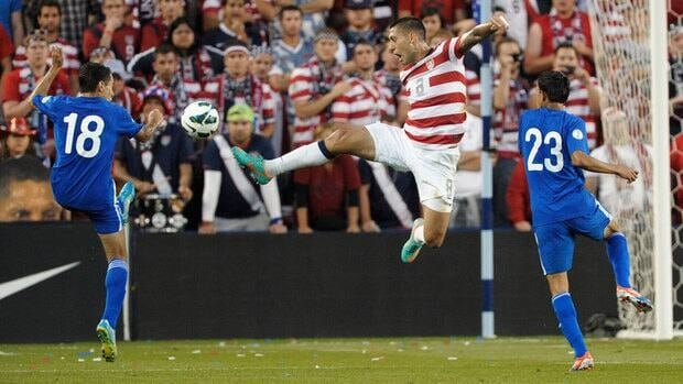 U.S. forward Clint Dempsey leaps for the ball between Guatemala midfielder Carlos Figueroa (18) and defender Jonathan Lopez (23) during the first half of a World Cup qualifying soccer match Tuesday.