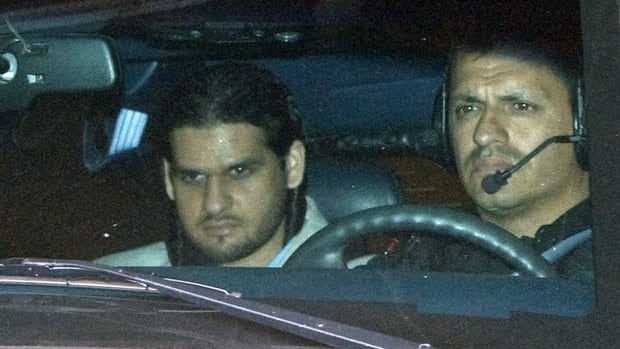 Momin Khawaja's appeal is before the Supreme Court of Canada on June 11. Khawaja, left, is transported from an Ottawa courthouse following a day of hearings, July 22, 2008.