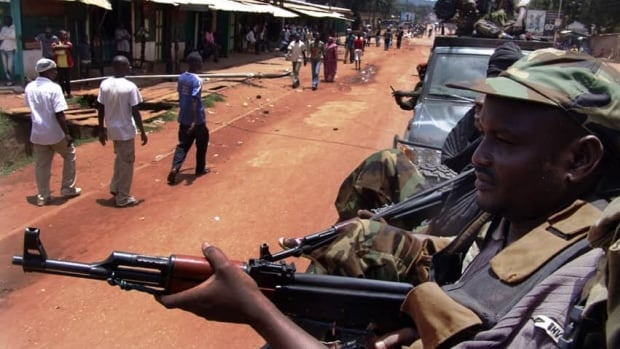 Armed fighters from the Seleka rebel alliance patrol the streets in pickup trucks to stop looting in Bangui earlier this week.
