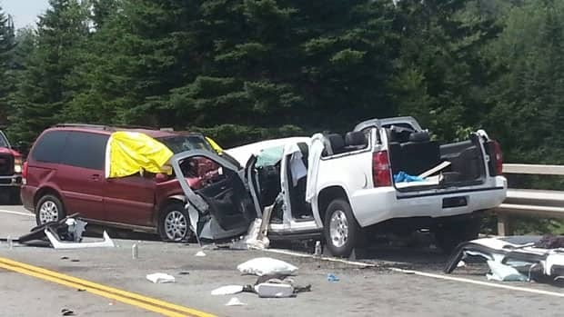 The white suburban and purple van were totalled in the crash. The section of Highway 103 is only two lanes.