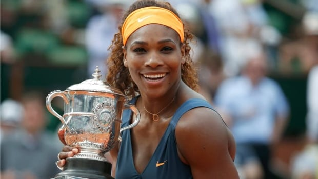 Serena Williams holds the Suzanne Lenglen Cup as women's singles champion at the French Open for the first time since 2002.