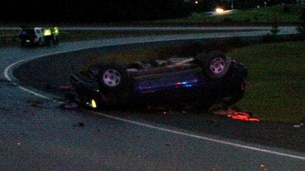 One man was taken to hospital with serious injuries after this car overturned on a Highway 102 ramp.