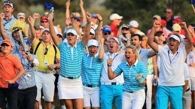 European Team members and caddies celebrate as Carlota Ciganda of Spain and the European Team makes a birdie putt on the 18th hole to win the match with her teammate Azahara Munoz of Spain during the afternoon four-ball matches at the 2013 Solheim Cup on Saturday.